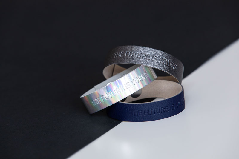 Three wristbands with a winning message